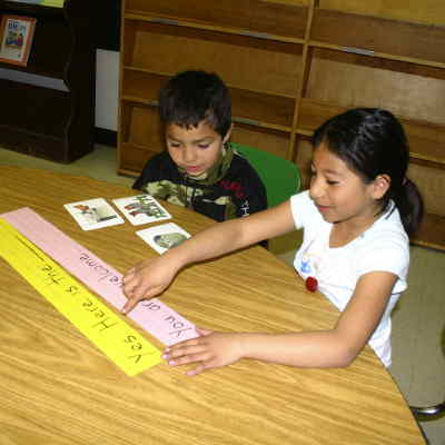 by: SHELBY CASE/CENTRAL OREGONIAN - Cecil Sly kindergartners Natali Lopez Chavez and Jose Vargas-Robles were busy Thursday afternoon reviewing courtesy expressions in English Language Development teacher Mary Duggan's class.