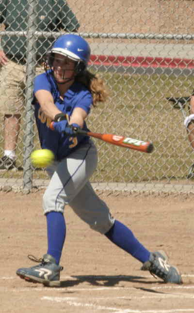 by: LON AUSTIN/CENTRAL OREGONIAN - Kaitlyn Duncan slaps teh ball toward third in the first inning of Crook County's doubleheader with Pendleton on Saturday.  The Cowgirls lost game one 7-0, then came back to win the second game 3-1 to give Pendleton their first loss of the season.