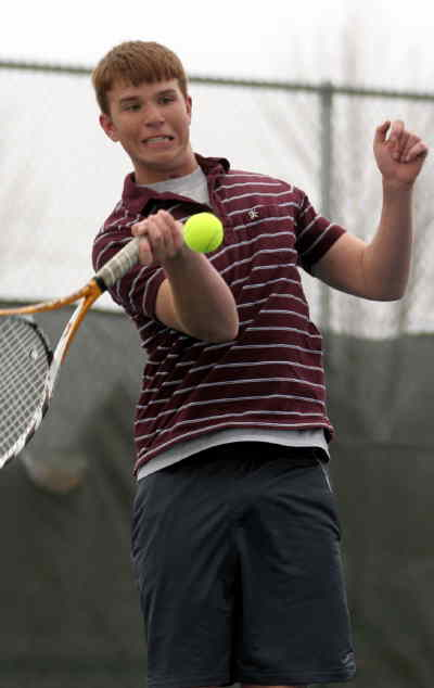 by: LON AUSTIN/CENTRAL OREGONIAN - Zac Thompson plays the ball in a recent match.  Thompson and his partner Joe Oehlshlaeger won the consolation bracket of the Treasure Valley Community College Invitational over the weekend.