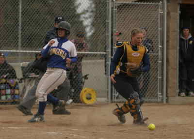 by: LON AUSTIN/CENTRAL OREGONIAN - Sydney Waite scores the go-ahead run for the Cowgirls in the eighth inning of Tuesday's game against Bend when the Bend catcher drops teh ball on what would have been a force-out.  The Cowgirls went on to win the game 13-6.