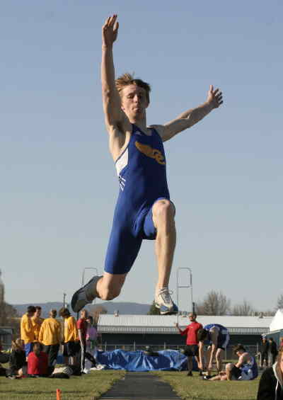 by: LON AUSTIN/CENTRAL OREGONIAN - Scott Elliot Jumps over 19 feet in the long jump on Wednesday to set a personal record.  Elliot also set a school record in the pole vault on the day clearing 14-03.5 to win the event