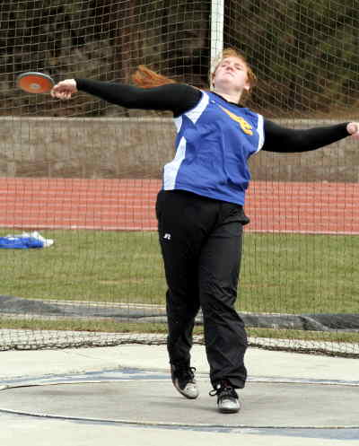 by: LON AUSTIN/CENTRAL OREGONIAN - Kady Stafford throws the discus against Bend on Wednesday.  Stafford won all three throwing events at Bend.