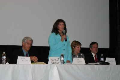 by: KEVIN GABOURY/CENTRAL OREGONIAN - Democratic candidate for judge Kim Kambak gives her closing statement at the Chamber candidate forum last night. Republican judge candidate Walt Wagner and district attorney Daina Vitolins are on the left and right