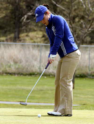 by: LON AUSTIN/CENTRAL OREGONIAN - Rachel Kelso putts on the second hole at Meado Lakes Golf Course on Friday.  Kelso shot a 97 for the day as Crook County finished third in the tournament