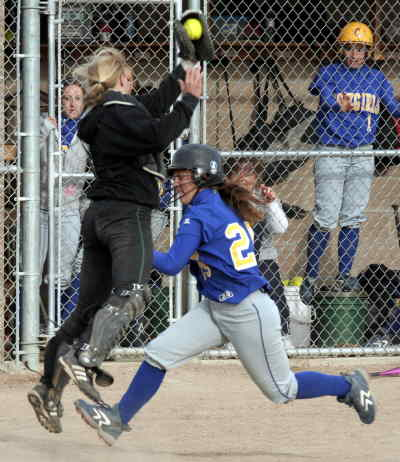 by: LON AUSTIN/CENTRAL OREGONIAN - Sydney Waites avoids a tag attempt and scores the winning run from second base on a single by Santana Reece in the bottom of the seventh inning.  Crook County came from behind to defeat the Storm in an important game that moved the Cowgirls into a tie for second place in the Intermountain Conference with Pendleton.