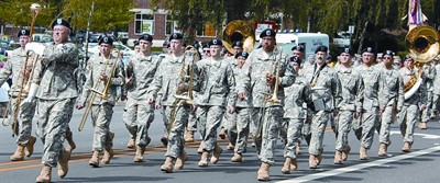 by: PHOTO CONTRIBUTED BY SERGEANT FIRST CLASS TERRY TUGGY - The Oregon Army National Guard's 234th Army Band marches in a parade during one of their performances in Oregon. The Band will be performing in the Crooked River Roundup Parade on Saturday, June 25 and will perform in the Pioneer Park from 11 a.m. to 12:30 p.m. on Saturday, also.