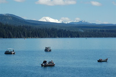 by: SCOTT STAATS SPECIAL TO THE CENTRAL OREGONIAN - Anglers try their luck on Diamond Lake with Mt. Scott in the background.