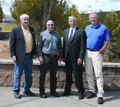 by: JASON CHANEY/CENTRAL OREGONIAN - Crook County High School distinguished alumni selection committee members Chuck Holliday (far left) and Steve Lent (far right) pose for a photo outside the high school with 2012 distinguished alumni Curt Berger (second from left), and Doug Whitsett (second from right).