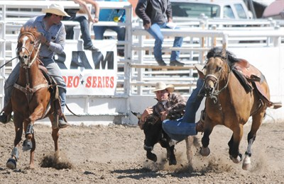 by: CENTRAL OREGONIAN - Christian Radabaugh competes in the second go round of steer wrestling. Radabaugh, of Prineville, finished third in the go round, and second in the average in the event at the three-day Crooked River Roundup.