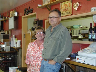 by: RON HALVORSON/CENTRAL OREGONIAN - Leta Pettit and Richard Redwine of Richie's Place, posing behind the restaurant's counter.