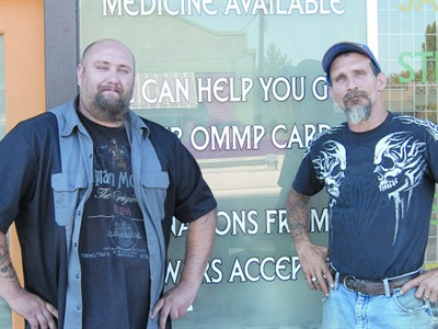 by: RAMONA MCCALLISTER/CENTRAL OREGONIAN - Ryan Cole and Robert Mills, co-partners for 5C (Crook County Compassion Clinic/Club), stand in front of their business on North Main Street, in Prineville.