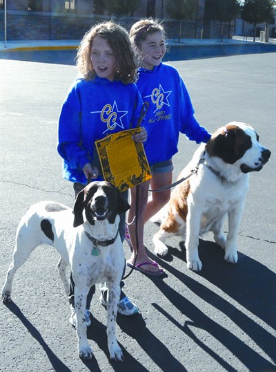 by: CENTRAL OREGONIAN - Abby Dalton (left) and Emily Ackley (right) walked their dogs in last year's Crook County Pet Parade.