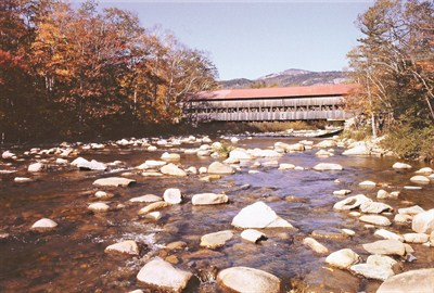 by: SCOTT STAATS SPECIAL TO THE CENTRAL OREGONIAN - A covered bridge only adds to the majestic beauty of New Hampshire in the Fall.