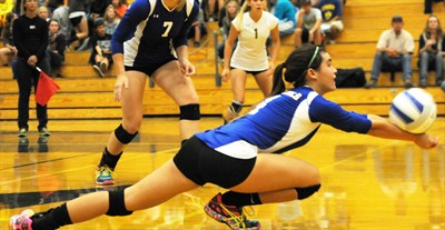 by: LON AUSTIN/CENTRAL OREGONIAN - Laken Berlin digs a ball during the Cowgirls' easy victory over the Redmond Panthers on Thursday.
