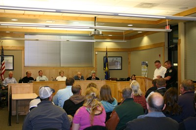 by: JASON CHANEY/CENTRAL OREGONIAN - Prineville City Councilor Dean Noyes and Prineville Police Chief Eric Bush (at podium) provide the rest of the City Council and the public some details on how a business license requirement might benefit Prineville.
