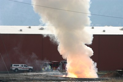 by: JASON CHANEY/CENTRAL OREGONIAN - The fire that was started by a spark to a highly-combustible pile of zirconium filings at EnviroTech on Tuesday resulted in a large column of smoke that drifted over Prineville throughout the day.