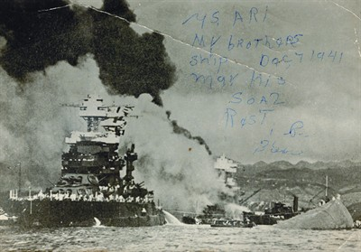 by: PHOTO CONTRIBUTED BY ART ROWE - In the above photo, the photographer was a survivor of Pearl Harbor when his ship, USS Utah, was destroyed during the raid on Pearl Harbor in 1941. The photographer's brother was on USS Arizona, and did not survive — as indicated by the writing on this historic photograph. In the foreground is a recent photograph taken of Roy Bunting, who was a gunner on USS Waters on Dec. 7, 1941.