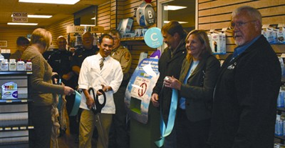by: JASON CHANEY/CENTRAL OREGONIAN - Clinic Pharmacy hosted a ribbon-cutting ceremony late last month to celebrate the installation of a new drug take-back box at their facility. Pictured left to right are Carly Rachocki, Brenda Comini,  James Young,  Michael Boyd,  Jim Hensley,  Sean Phophiyane, Joe Becker,  Daina Vitolins, and Bill Gowen.