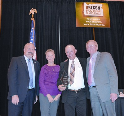 by: CONTRIBUTED PHOTO - Doug Breese was inducted into the Oregon Farm Bureau Hall of Fame earlier this month. Pictured left to right are Oregon Farm Bureau Vice-President Dave Dillon, Jean Breese, Doug Breese, and Oregon Farm Bureau President Barry Bushue.