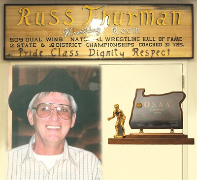 by: CENTRAL OREGONIAN - Russ Thurman coached wrestling for more than 30 years, many of them at Crook County. The popular coach passed away this year. Thurman won 509 dual meets, two state championships, and 18 district titles in his coaching career. In November, the Crook County High School wrestling room was named after Thurman.
