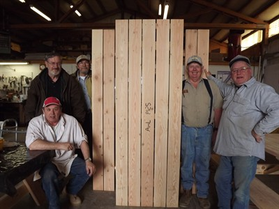 by: Submitted photo - Local veterans Larry McLean, left, Everett Elliot (behind), Jon Granby, Dave Stevenson and Ray Willis stand with one of the 22 picnic tables they have made.