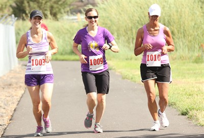 by: Photo By Joe McHaney - Melinda Grote (1003), Jennifer Vaught (1009) and Denise Garcia (1010) compete in the Living Hope Christian Center 10K race June 2 in Madras.