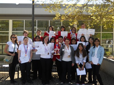 by: Submitted Photo - MHS SkillsUSA contestants hold trophies won at the state competition.
