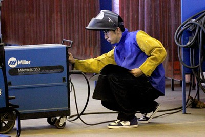 by: Photo By Joe McHaney - Elmer Felix adjusts a welding maching during Central Oregon Community College welding class.