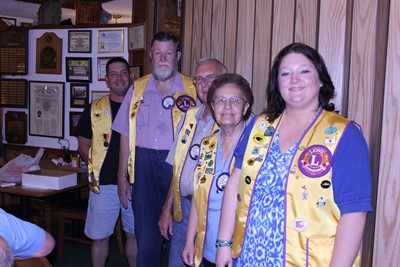 by: Photo by Susan Matheny - New Madras Lions CLub officers installed last week are, right to left, President Jennifer Flowers, First Vice President Dennis Hardman, Treasurer Roger Tathwell, Secretary Elaine Henderson, and tail twister/lion tamer, shared by Ollie Orcutt and Steve Keever.