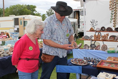 by: Photo by Holly M. Gill - Vesta and Ron Williamson, of Corvallis, examine a rock at the annual All Rockhounds Powwow Club of America event at the fairgrounds on Friday. The Williamsons, who attended for the first time, were among dozens of vendors at the five-day event.