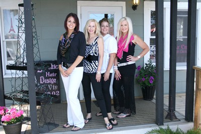 by: Photo By Joe McHaney - From left to right, Le' Chic Hair Design employees Sarah Dominiak, Cindi Avila, Margee Moschetti and Kathlene Withrow are now doing business at 156 S.W. Third St. in Madras.