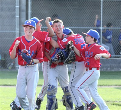 by: Photo By Joe McHaney - Jefferson County catcher Tyler Lockey is mobbed by teammates, while teammate Lewis Fine gives a fist pump after the team's victory over Crook County in the District 5 Little League Majors baseball tournament July 1 at Juniper Hills Park in Madras.