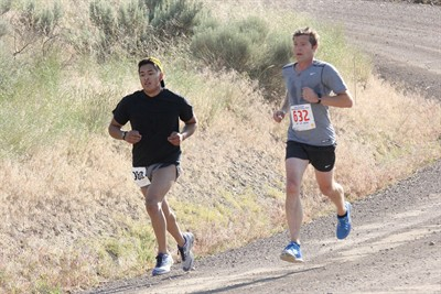 by: Photo By Joe McHaney - Freddie Hernandez, left, and Michael Donaghu compete during the 15th annual Todd Beamer Independence Day Memorial Run on Grizzly Road. Donahue edged Hernandez for first place in the 10K run.