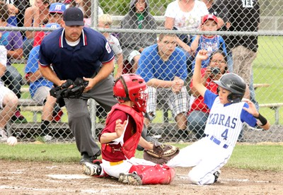 by: Photo By Joe McHaney - Jefferson County's Jeremiah DeVore slides safely into home plate June 30 during a District 5 Little League Minors baseball game against The Dalles at Juniper Hills Park in Madras.