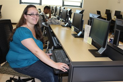 by: Photo by Susan Matheny - COCC student Amber Paplia also works maintaining the computer lab at the Madras center.