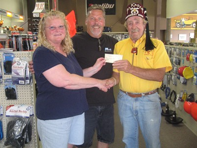 by: Submitted Photo - Shriner Larry Easter, right, presents a check for $500 to raffle winners Janet and Gary Walker.