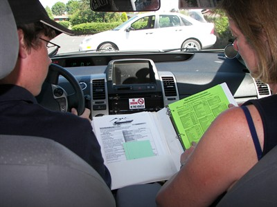 by: Submitted Photo - An instructor goes over driving rules with a student.