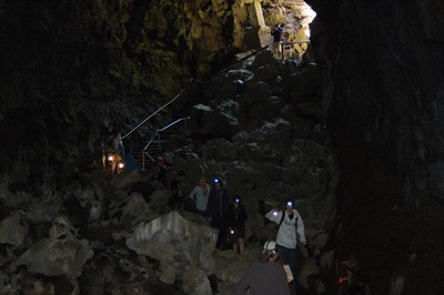 by: Photo By Scott Staats - Lava River Cave is the longest lava tube in Oregon at almost one mile long. In places, the cave is 58 feet high and 50 feet wide. Above, people enter the Lava River Cave to explore the cave.