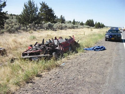 by: Photo courtesy of Oregon State Police - The driver of a Subaru wagon, which collided with the side of a commercial trailer, was critically injured in a crash Aug. 15.