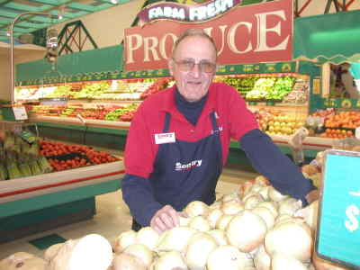 by: Photo By Susan Matheny - Erickson's produce manager Butch Ayres