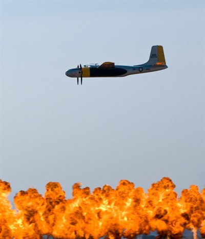 by: Photo by Tom Brown - Aviator Renny Price flies over the Wall of Flames at the Budweiser Airshow of the Cascades over the weekend.