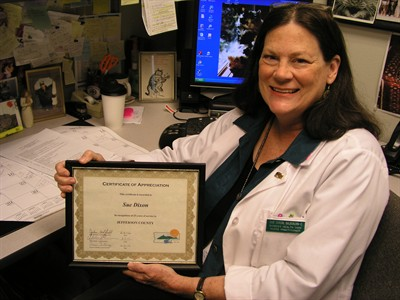 by: Submitted photo - Sue Dixon, of Bend, who has commuted to work at the Jefferson County Public Health Department for the past 25 years, displays a certificate of appreciation from the department for her achievement.