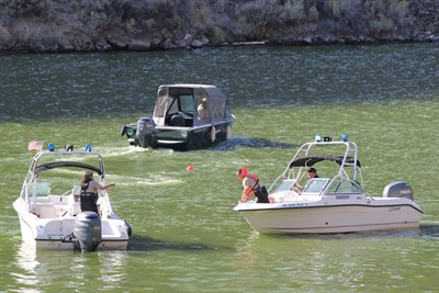 by: Photo By Holly Gill - Sheriff's marine patrol personnel searched for the body of Gene Harris at Lake Billy Chinook on Aug. 6.