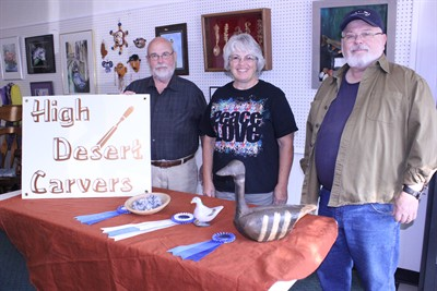 by: Photo by Susan Matheny - High Desert Carvers members Bill Montgomery, left, Sharon Miller, and Royce Embanks show their prize-winning carvings from the Columbia Flyway Show.