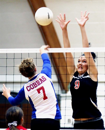 by: Bily Gates/The Pioneer - Culver's Cassandra Fulton attempts to block an attack by Central Linn's Sydney Belcastro during the Bulldogs' 3-0 win in a Class 2A Tri-River Conference volleyball match Thursday night in Culver.