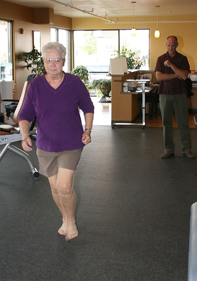 by: Billy Gates/The Pioneer - Donita Harris, 72, of Madras, runs barefoot in the Madras Physical Therapy office under the watchful eye of physical therapist Trevor Groves last week. In an effort to help control her Diabetes, Harris said she enjoys running barefoot simply because it feels better.