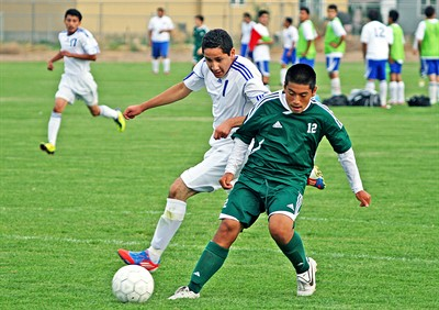 by: Billy Gates/The Pioneer - Madras midfielder Gustavo Pacheco (1) battles for the balls with a North Marion players during the Buffs' 5-4 loss to the Huskies on Thursday at Madras High School. Pacheco, a freshman, recorded a hat trick (three goals) in the match.