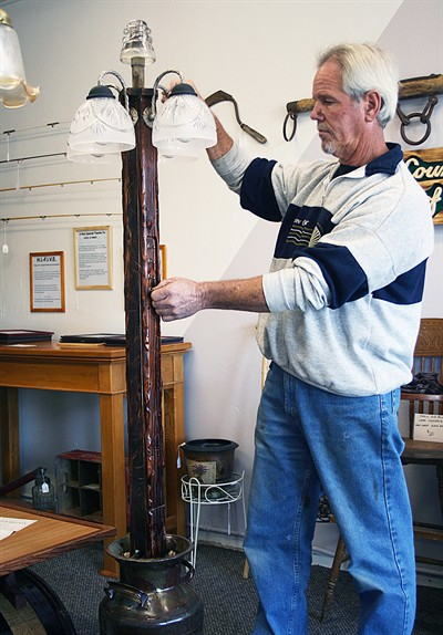 by: Photo by Billy Gates - Jack Barron, seen here steadying a lamp he made, sells handcrafted items at his new shop, Jack's Place.