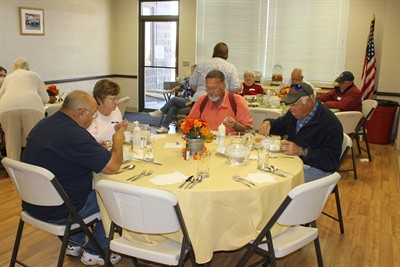 by: Photo by Susan Matheny - Seniors at last Thursday's meal were served at tables decorated with tablecloths and flower arrangements.