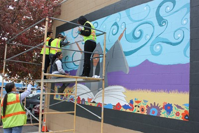 by: Photo By Susan Matheny - Girls Advisory Board member Sonya Littledeer, left, points out a spot on the mural being painted last Friday by teens Kathy Madrigal, on left, Cecelia Mejia-Ochoa, Jessica Corona and Destiny Cobucci (not pictured Breann Martin).